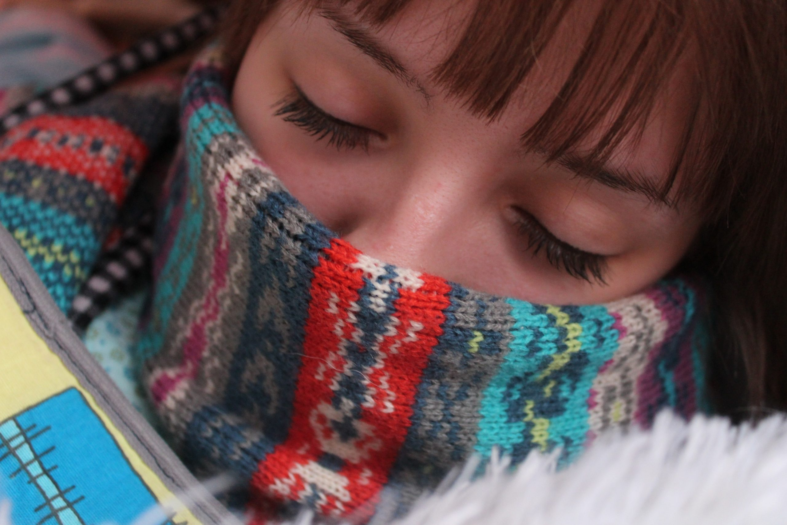 Cold: Woman with face wrapped in a scarf